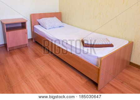 Sleeper - A Bed And A Bedside Table In The Interior Of The Room, Close-up