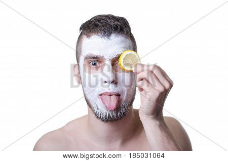 Young Man With Clay Mask On His Face, Isolated On White.