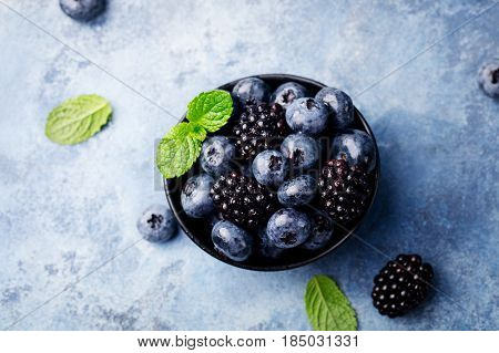 Fresh Blueberry And Blackberry Berries With Mint Leaves. Top View. Copy Space.