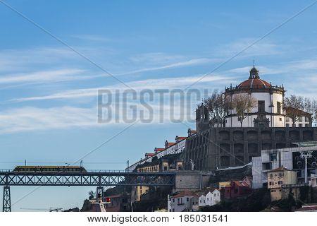 Dom Luis I bridge seen from Vila Nova de Gaia city Portugal. View with Serra do Pilar monastery