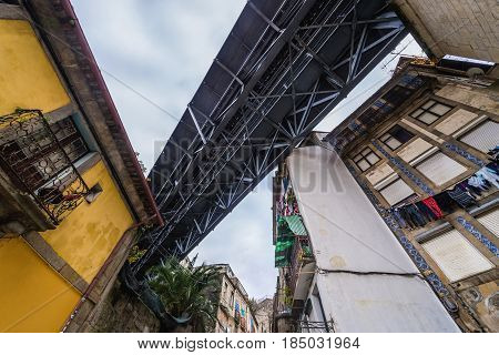 Old houses under the steel bridge of Dom Luis I in Porto Portugal