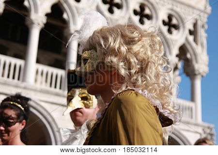 People In Costumes And Masks At The Venice Carnival In Italy