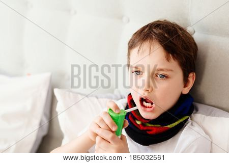 Little Boy Child Inhaling His Throat With Spray Inhaler