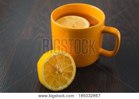 Cup Of Tea With Lemon On Table Close-up. Healthcare, Traditional Medicine And Flu Concept - Tea Cup