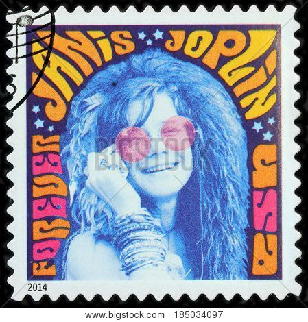 LUGA RUSSIA - APRIL 26 2017: A stamp printed by USA shows image portrait of Janis Lyn Joplin - famous American singer of the 1960s circa 2014