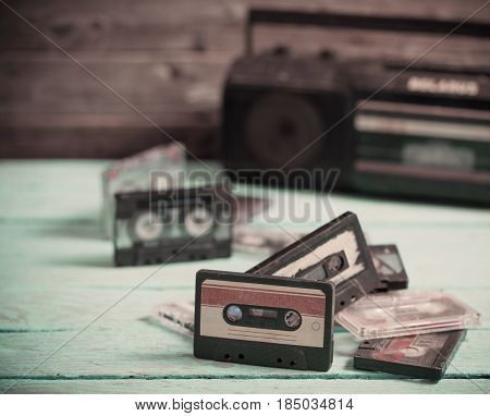 old cassette tape and player on the wood background