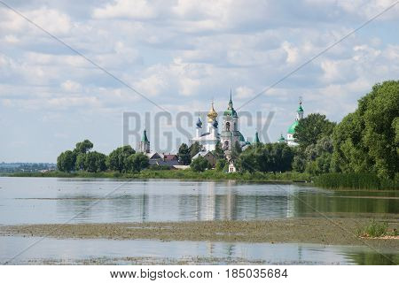 Nero Lake and the Spaso-Yakovlevsky Dmitrovsky monastery on a July cloudy day. Rostov Veliky. Golden Ring of Russia