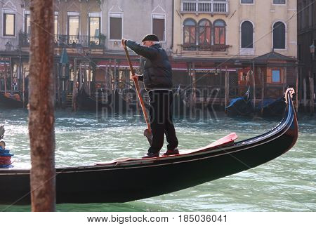 Gondolier On A Canal In Venice, Italy