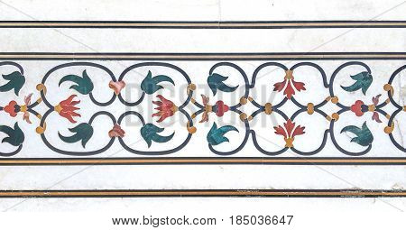 exterior trim of gem stones on white marble background at mausoleum Taj Mahal Agra Uttar Pradesh state India