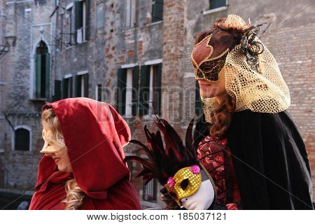 Women In Costumes And Masks At The Venice Carnival In Venice, Italy