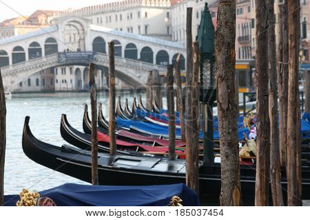 Gondolas Parked On The Grand Canal In Front Of The Rialto Bridge, Venice, Italy
