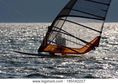 Windsurfer riding on Lake Garda in Italy