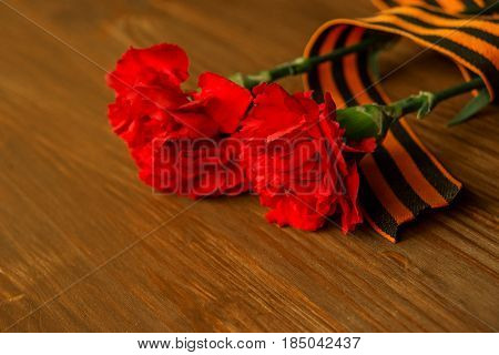Carnation Flowers And George Ribbon On Abstract Light Background. Victory Day - May 9. Jubilee 70 Ye