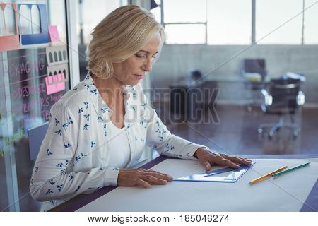 Interior designer working on desk at office