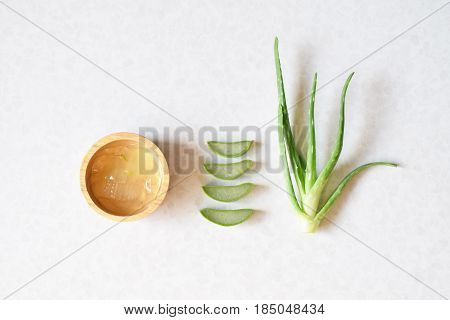 Aloe Vera slices and pieces on bowl on white background.