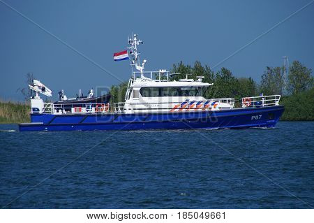 Almere Pampushaven, Flevoland, The Netherlands - May 6, 2017: Dutch National Police Patrol vessel P 87 sailing in the harbor of Pampushaven in the city of Almere