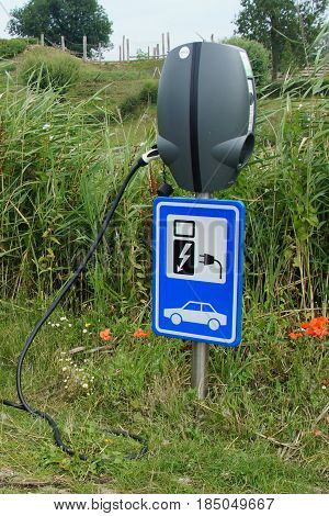 Herwijnen, The Netherlands - July 24, 2015: Public electric car charging stations.