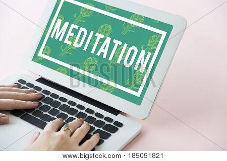 Meditation word on green background