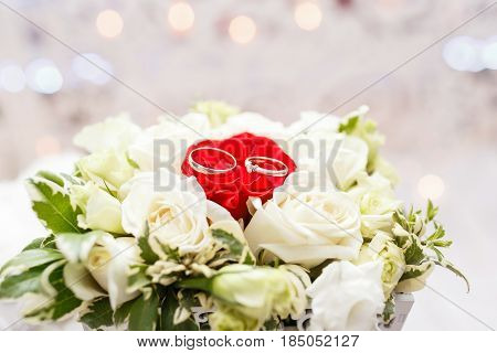 Set of wedding rings in Red and white rose taken closeup. wedding concept. selective focus.