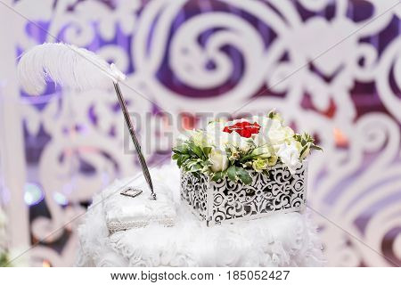 Set of wedding rings in Red and white rose taken closeup. wedding concept. selective focus. flower arrangement box for rings accessories. the ceremony of marriage.