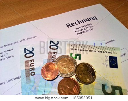 Some euro notes and coins with invoice