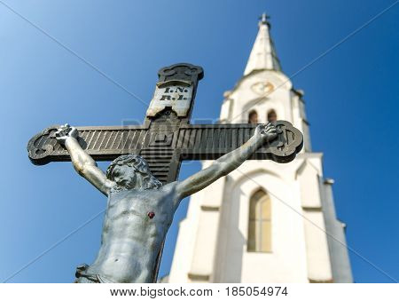 statue of Jesus Christ in front of a catholic church