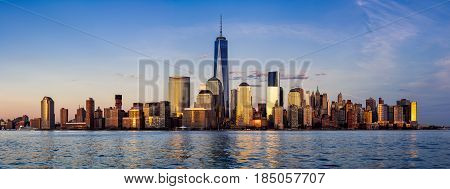 Panoramic of New York City Financial District skyscrapers and Hudson River at sunset. Lower Manhattan