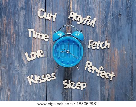 clock and words on blue color background.
