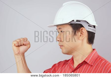 Engineer Wear Red Shirt And White Hat Make Signal Fist