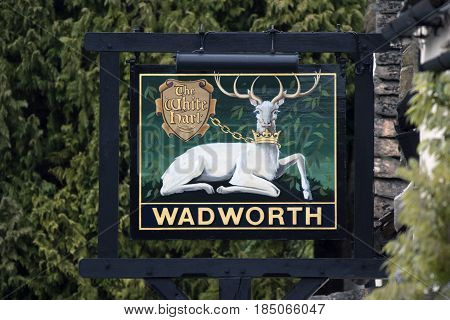 CASTLE COMBE UK - MAY 1 2017: The White Hart Wadworth Pub sign in Castle Combe Wiltshire UK