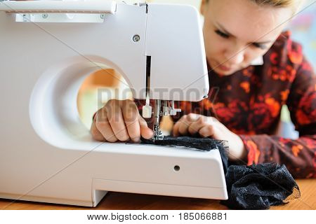 Young Woman Sewing  With Sewing Machine