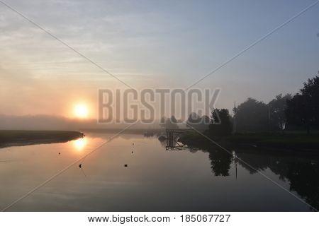 Sun reflecting in Duxbury Bay on a foggy morning.