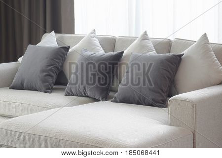 Two Tone Pillows Lay On Beige Sofa In Living Room