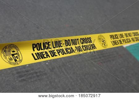 LOS ANGELES California- May 1, 2017: Los Angeles Police Department Barrier Tape at a Protest Rally Against President Donald J. Trump on May 1, 2017 in Los Angeles, California