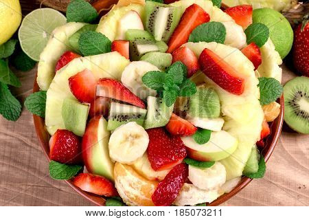 Freshly prepared fruit salad with various fresh and organic fruits, fruit salad in bowl