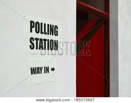 Polling station place for voters to cast ballots in general elections red door
