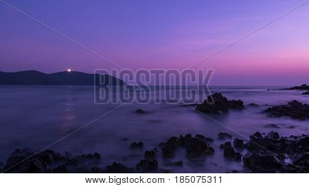 Long exposure of seascape with rock in twilight time.