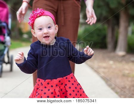 Adorable Baby Taking First Steps