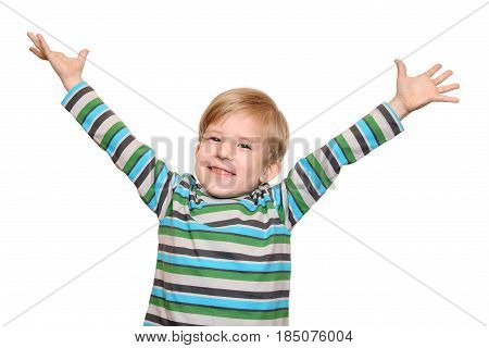 Joyful kid with arms outstretched welcomes isolated on white background