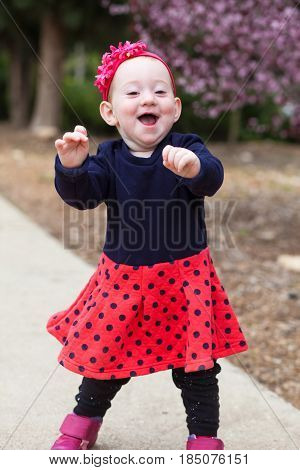 Laughing Baby Taking First Steps