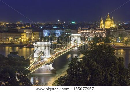 Panorama of Budapest landmark hungary Chain Bridge and Danube river from Buda castle hill in blue hour.