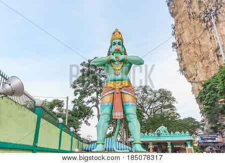 KUALA LUMPUR, MALAYSIA - AUGUST 15, 2016: A Hanuman statue is a Hindu god which is located beside of the Batu Caves is entrance in Kuala Lumpur Malaysia.