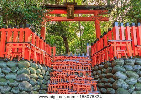 KYOTO, JAPAN -APRIL 15, 2015: Wishing Wooden Torii at Fushimi Inari Taisha Shrine the head shrine of Inari including trails up the mountain in Kyoto Japan.