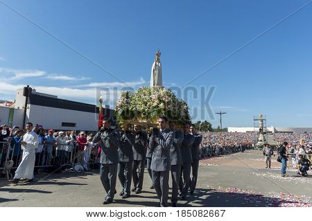 Fatima Portugal - May 13 2014: Group of soldiers carrying the Statue of the Virgin Mary at the Sanctuary of Fatima during the celebrations of the apparition of the Virgin Mary in Fatima Portugal.