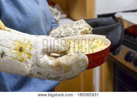 Woman With Oven Mitts Holding