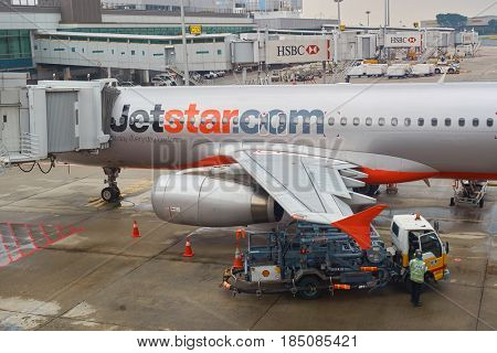 SINGAPORE - CIRCA SEPTEMBER, 2016: Jetstar aircraft on the tarmac in Changi Airport. Jetstar is an Australian low-cost airline headquartered in Melbourne.