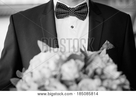 Grooms morning preparation. Handsome groom getting dressed and preparing for the wedding
