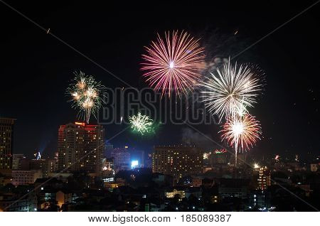 New Years Eve fireworks captured expanding over the city in a time lapse photo.