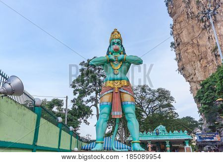 KUALA LUMPUR MALAYSIA - AUGUST 14, 2016: A Hanuman statue is a Hindu god which is located beside of the Batu Caves is entrance in Kuala Lumpur Malaysia.