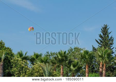 Parachuting over a sea towing by a boat